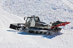 Tractor for snow preparation Stock Photos