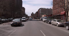 Driving along 1st Avenue in the East Village in Downtown Manhattan Stock Footage