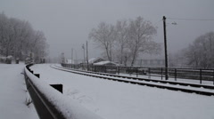 Empty train tracks during snow storm Stock Footage