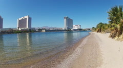 Colorado River Beach And Casino Hotels In Background- Laughlin NV Stock Footage