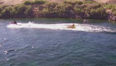 Jet Ski Pulling Inflatable Raft With People- Colorado River- Laughlin NV Stock Footage