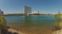 High Rise Casino Hotels Across Colorado River Wide- Laughlin NV Stock Footage
