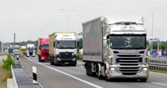 Busy traffic trucks border to Germany Netherlands Stock Footage
