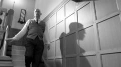 1950s styled men meet at bottom of stairs in film noir setting 4K Arkistovideo