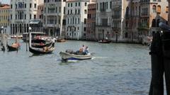 Gondolas and ferry close to the Ponte di Rialto in Venice Italy Stock Footage
