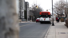 Bus departs from stop light Stock Footage