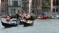 Stock Video Footage of Close up from Gondolas close to the Ponte di Rialto in Venice Italy