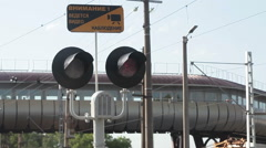 Red light on the semaphore at the railway crossing, sign of video surveillance Stock Footage