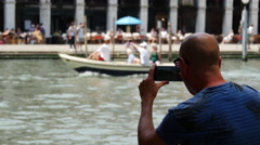 Man filming with his Samsung S6 a gondola in Venice Italy Stock Footage