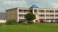 Texas Girl Found at Days Inn, FBI agent shot - stock footage