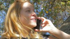 Blonde Causcasian girl alking on phone 4K 2160p UHD video - Modern girl outdo Stock Footage