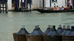 Wine bottles with Gondola at the background in Venice, Italy - stock footage