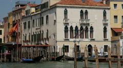Water taxis passing each other in Venice Italy Stock Footage