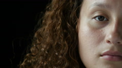 Close up of half of a woman's face Stock Footage
