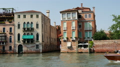 Water taxi passing by in Venice Italy Stock Footage
