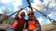 male Caucasian children boys park outdoor lifestyle active play vacation - stock footage
