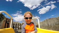 portrait male Caucasian child boy playground outdoor lifestyle active vacation - stock footage