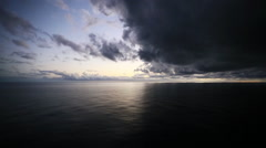 Storm clouds approach over ocean Stock Footage