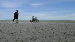 Father And Daughter Taking Selfie On Sand Bar During Bike Ride Stock Footage