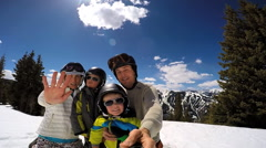 Portrait lifestyle leisure Caucasian family parents boys snow vacation outdoor Stock Footage