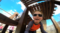 Stock Video Footage of Caucasian family playground child boy healthy outdoor lifestyle playing vacation
