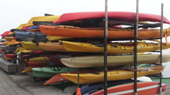 Stack of sea kayak and canoe rentals - stock footage
