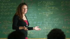 Math teacher instructs her students Stock Footage