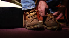 Working man ties boots Stock Footage