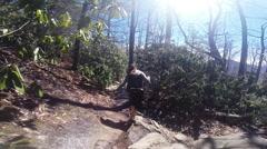 POV female hikes rocky trail Stock Footage