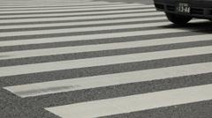 Traffic at zebra crossing in Yurakucho area, Tokyo, Japan Stock Footage