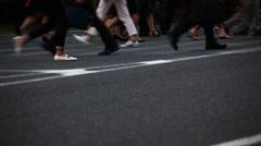 Pedestrians walking at zebra crossing in Yurakucho, Tokyo, Japan Stock Footage