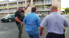 Texas Girl Found at Days Inn, FBI agent shot - stock footage