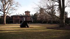Wide shot sculpture outside art museum - stock footage