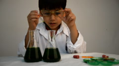 Little boy learning in chemical in science in class Stock Footage