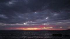 Spectacular Beautiful Red Luminous Clouds Over Sea Sunset Seascape Rocky Beach 2 - stock footage