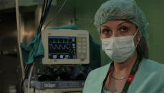 Anesthesiologist monitoring patient condition during surgical operation,close up - stock footage