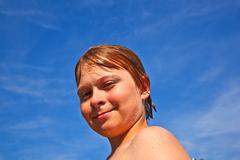 child has fun in the pool - stock photo
