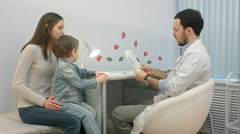 Pediatrician, mother and child atdoctor office Stock Footage