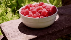 Raspberries In A White Bowl, On A Rustic Bench Stock Footage