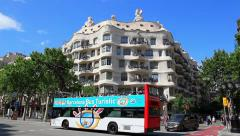 Casa Batllo facade by Antoni Gaudi and Tourist buses in Barcelona, Spain Stock Footage