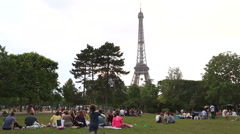 Parisian enjoy the park near the Eiffel Stock Footage