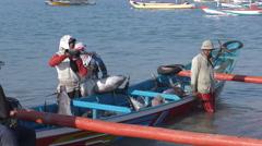 Bali Jimbaran Fish market unloading tuna from boat  4K Stock Footage