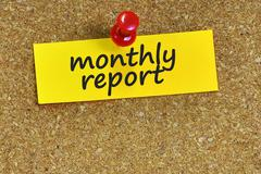 monthly report  word on notes paper with cork background - stock photo