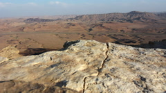 Wild Aerial desert landscape of Makhtesh Ramon  in the Negev desert , Israel - stock footage