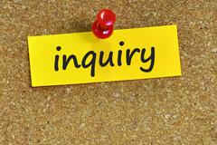 Inquiry  word on notes paper with cork background Stock Photos
