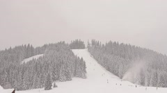 Beautiful snow-covered mountain panorama. Evergreen spruces covered with snow. - stock footage