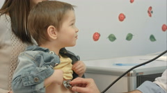 Stock Video Footage of Hospital: Doctor Checks Heartbeat Of Young Boy