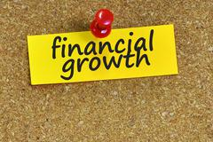 financial growth  word on notes paper with cork background - stock photo