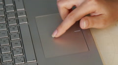 Hands Using a Touchpad Mouse of laptop keyboard Stock Footage