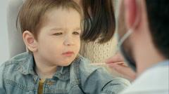 Little boy having throat examination - stock footage